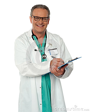 Experienced male doctor making report