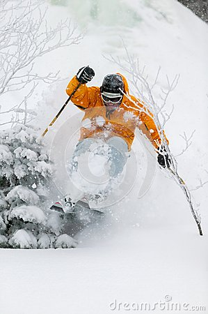Expert skier skiing powder snow in Stowe, Vermont,