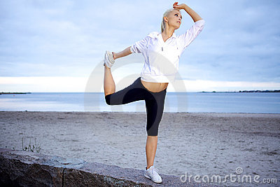 Expert yoga pose on beach