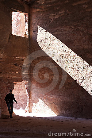 Explorer in historic and famous cave of petra
