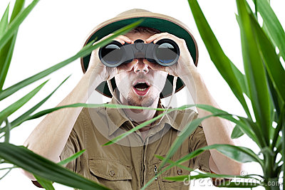 Explorer looking through binoculars