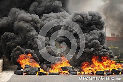 Explosion and burning wheels causing huge dark smo