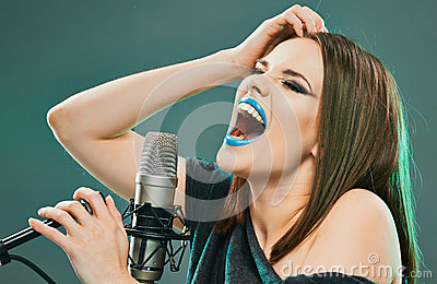 Expression woman singer portrait with microphone.