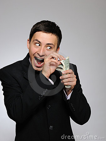 Free Expressions.Young Handsome Business Man With Money Royalty Free Stock Photography - 16650147