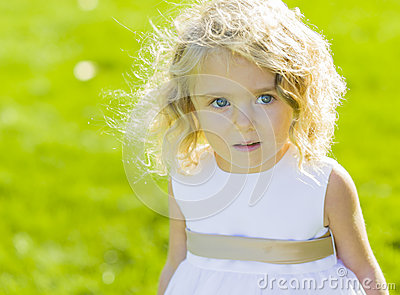 Expressive Little Girl in White Dress