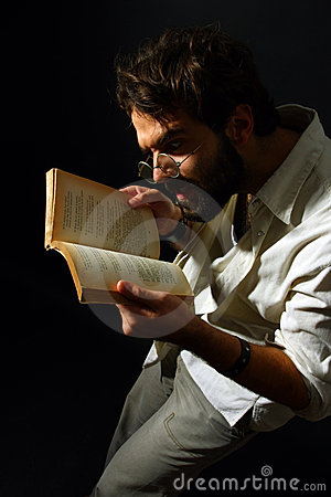 Expressive man reading a book