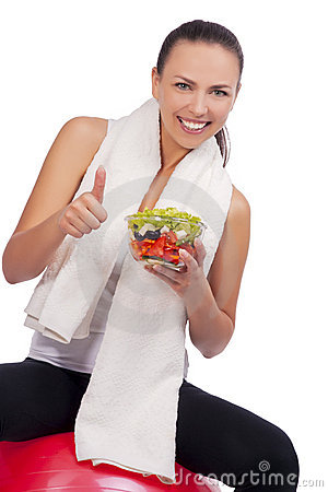 Expressive positive woman with salad