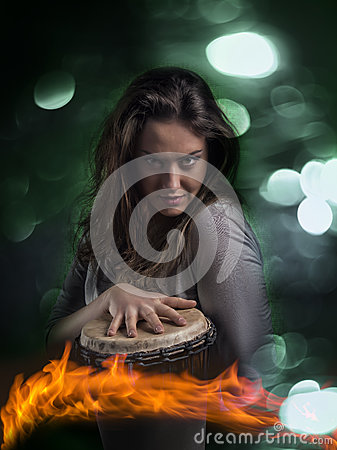 Free Expressive Wild Woman Playing Djembe Drum Stock Images - 45169444