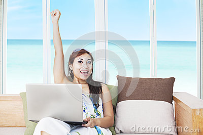 Expressive woman with laptop
