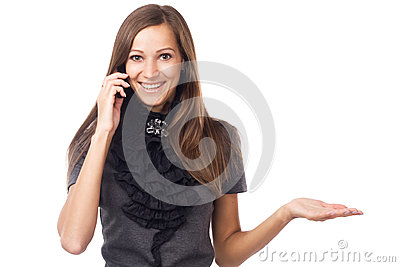 Expressive young woman talking on mobile phone