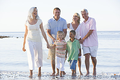 Extended family at the beach smiling