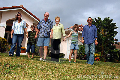 Extended family in front of home