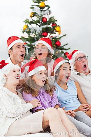 Extended family singing carols