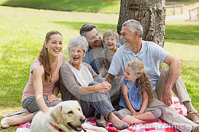 Extended family with their pet dog at park