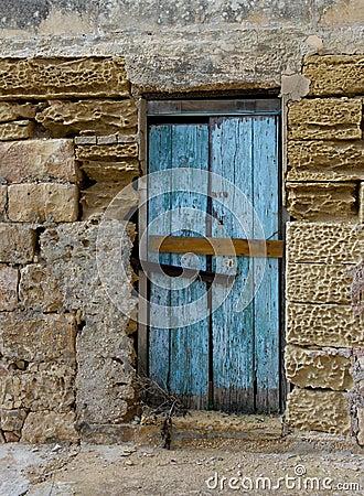 Exterior,Old door fragment, old door texture view, abstract scene, nobody at home, weathered door, close door in bright wall