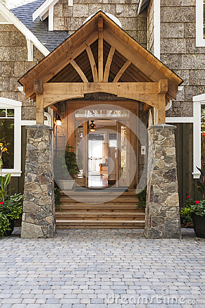 Free Exterior Porch And Front Door Entrance To Beautiful, Upscale Country House With High Quality Wood And Stone Building Materials Royalty Free Stock Photo - 96358975