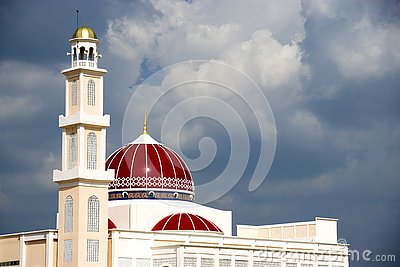 Exterior of red domed mosque