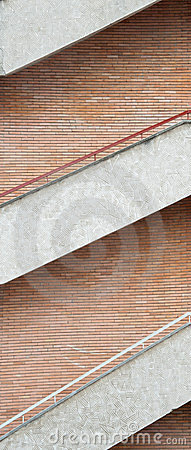 External stairs against a red brick wall