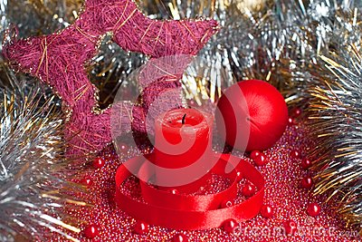 Extinguished candle with christmas decorations