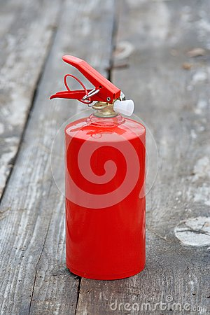 Extinguisher on the wooden sidewalk