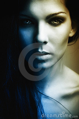Extravagant beautiful girl dark portrait