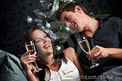 Extravagant couple with champagne on Christmas