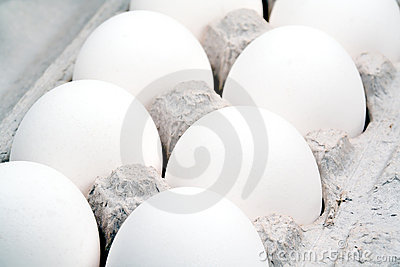 Extreme closeup of a dozen eggs