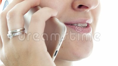 Extreme closeup video of young woman talking by phone and smiling. Extreme closeup footage of young woman talking by phone and smiling stock video footage