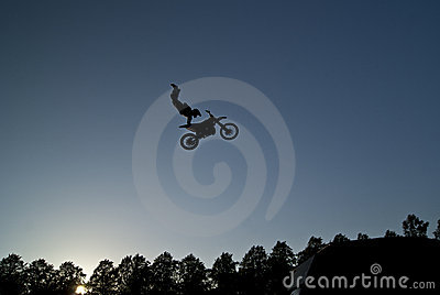 Motorcycle stunt rider in midair