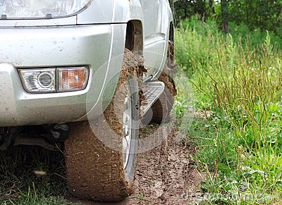 Extreme offroad behind  car in mud