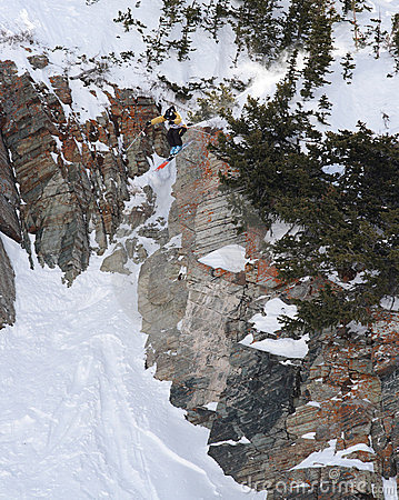 Extreme skiing off a big cliff