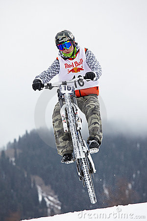 Extreme snow mountain biking Editorial Stock Image