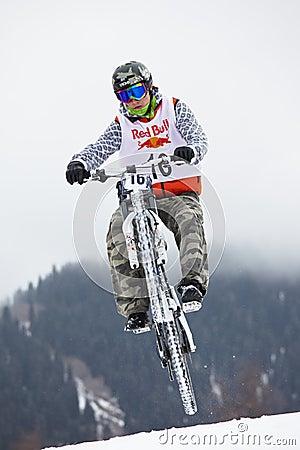 Extreme snow mountain biking Editorial Stock Image