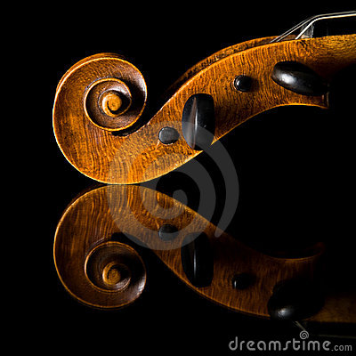 Extremely old scratched violin pegbox and scroll,