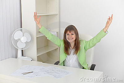 Exulting girl at office on workplace