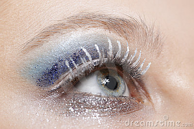 Eye with blue and silver sparkle make-up