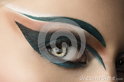 Eye closeup with makeup. looks at right