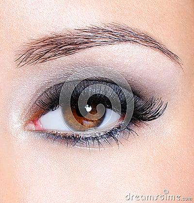 Eye with dark brown glamour make-up