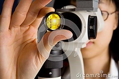 Eye Doctor examing your eyes