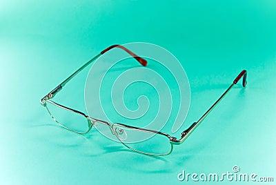 Eye-glasses on a green backgro