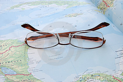 Eye glasses on map