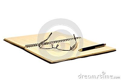 Eye glasses on planner