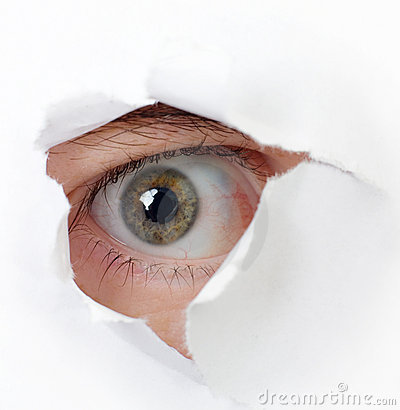 Eye looking through a hole