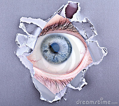 Eye looking through torn gap