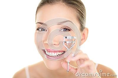 Eye makeup woman using eyelashes curler for mascara. Face care asian beauty girl