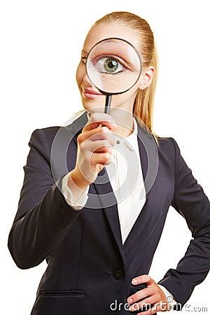 Free Eye Of Businesswoman Through Magnifying Glass Royalty Free Stock Photo - 65190215