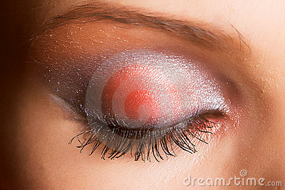 An eye with sparkly make up