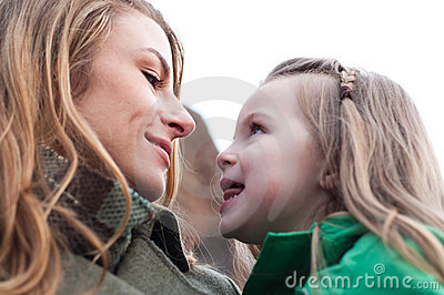 Eye-to-eye contact of girl and her mom