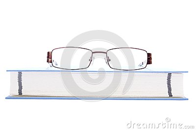 Eyeglasses on the blue book