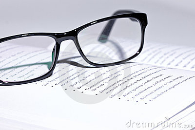 Eyeglasses lie on the book